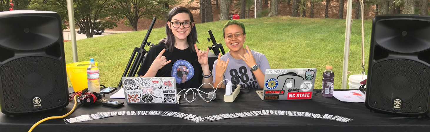 Laura Mooney and Leeann Diaz DJ for WKNC at the Parents and Family Services tailgate on Sept. 29, 2018.